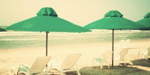 Green Umbrellas at the Beach
